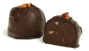 Topped with an almond garnish and dark chocolate strings. The creamy dark chocolate center is flavored with the nutty sweetness of Amaretto and enrobed in a rich dark chocolate shell..