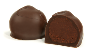 Topped with a swirl. The rich dark bittersweet chocolate center shines on its own without any added flavors. Encased in a dark chocolate shell, this truffle is the essence of chocolaty goodness..