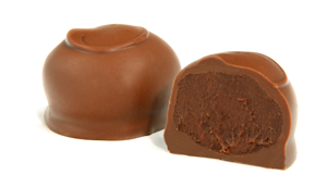 Topped with a swirl. Pure milk chocolate ganache is covered in a layer of creamy milk chocolate.