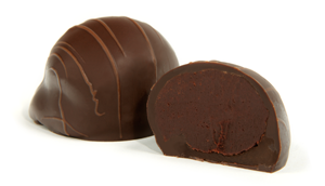 Drizzled with milk chocolate strings. Rich dark chocolate is coupled with the fruity sweetness of a French raspberry liqueur then encased in a dark chocolate shell.