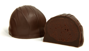 Drizzled with dark chocolate strings. The rich, flavorful semi-sweet center has a true chocolate taste that stands alone. Enrobed in a dark chocolate shell, this truffle is slightly sweeter than the Bittersweet.