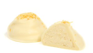 A white truffle sprinkled with lemon zest. White chocolate ganache infused with a full natural lemon flavor. Shrouded in white chocolate.
