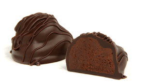 Drizzled with dark chocolate strings. The creamy ganache center is a blend of four European dark chocolates with no added flavoring. This truffle is our ultimate dark chocolate experience.